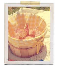 Line old bushel baskets for laundry or other storage. This photo is from a tutorial for a charming picnic basket.