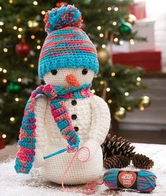 This Crazy Cute Crocheting Snowman will have you wishing for a snowstorm. This sweet crochet snowman has a miniature skein of Red Heart yarn, as well as a tiny crochet hook, so the two of you can work up a pattern together.