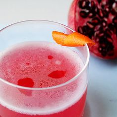 ruby yacht cocktail: pomegranate juice, simple syrup, prosecco, orange twist