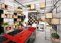 Steel rebar forms storage system at Toronto kitchen showroom by DesignAgency.