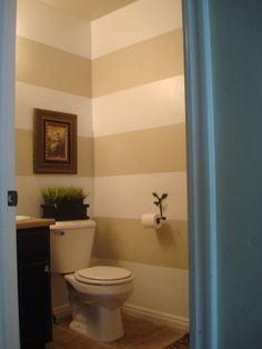Really like the striped walls. Especially in a small powder room. Making a statement!
