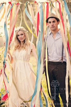 fabric strips in the wind make a wedding photobooth backdrop.