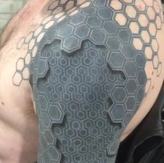 A tattoo with amazing 3D-looking depth makes a man's arm look like it belongs to a shape-shifting android with peeling skin. Even famous street artist Banksy thinks it's cool.
