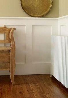 Beef up a wainscot cap so that it doubles as a display shelf by swappng your existing cap for 1x3 trim edged with nose-and-cove molding. The resulting ledge is deep enough for propping family photos. Preprimed MDF 1x3, about $4 for 8 feet, and nose and cove, about $2 per linear foot; at lumberyards.   Photo: David Prince   thisoldhouse.com by sherri