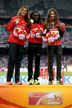 (L-R) Silver medalist Habiba Ghribi of Tunisia, gold medalist Hyvin Kiyeng Jepkemoi of Kenya and bronze medalist Gesa Felicitas Krause of Germany pose on the podium during the medal ceremony for the Women's 3000 metres steeplechase final during day six of the 15th IAAF World Athletics Championships Beijing 2015 at Beijing National Stadium Beijing National Stadium, Team Toyota, World Athletics, Kenya, Olympics, Christmas Sweaters, Athlete, Germany, Bronze