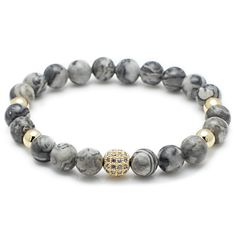 Jasper is known as a spiritual stone and as such it makes for a classic bracelet. The pave diamond spacer is the perfect accent for the smooth gray stone. - Size 7 - 6mm Gray Jasper Stone Beads - 8mm