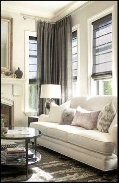 Solution for window treatments - light control shades inside window frame, high-mounted curtains. Run past door?
