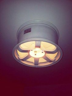 Re-purposing a 7 spoke wheel as room light fixture.