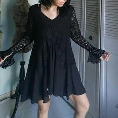 Bo-ho Black Lace V-neck Tunic Top Adorable and on trend, this is an absolute gorgeous top by The Pyramid Collection size XL. In excellent used condition. Can be worn as a mini dress as pictured or tunic. I wear a XS-S,  tag on this is XL. 100% Polyester.  Flat lay measurements are 32' length / 23' bust armpit to armpit / 23' sleeve length. Please let me know if you have any additional questions before purchasing. No lowballs! Vintage Tops Tunics