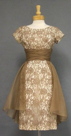 This dress is so fabulous.  One day I am going to take this picture to a dress maker and have it copied~