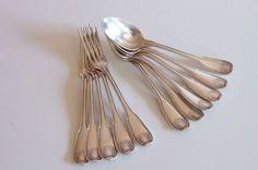 Couverts de table modèle coquille métal argenté