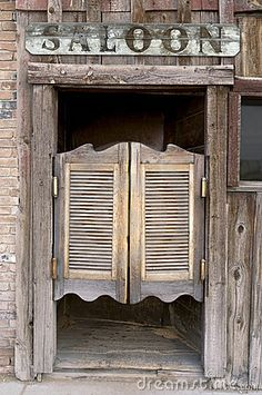 Old Western Swinging Saloon Doors by Carl Keyes, via Dreamstime