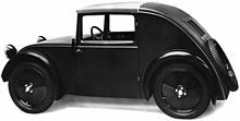 """Tatra V570 prototype (1933) First model of the Standard Superior, as introduced at the IAMA in Berlin in 1933 Josef Ganz designed a car the """"May Bug"""" that is very similar to the Volkswagen Beetle. Hitler saw the car in 1933 at an auto show.  ... Tatra built the V570 prototype, which had an air-cooled flat-twin engine mounted at the rear. Both Hitler and Porsche were influenced by the Tatras... Hitler ... remarked to Porsche, """"This is the car for my roads"""".   [wikipedia]"""