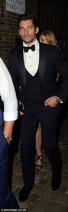 Dapper gents: Dermot O'Leary looked handsome in a navy tuxedo while model David Gandy went for a three piece tuxedo