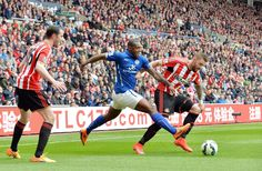 Wes Morgan in action with Connor Wickham