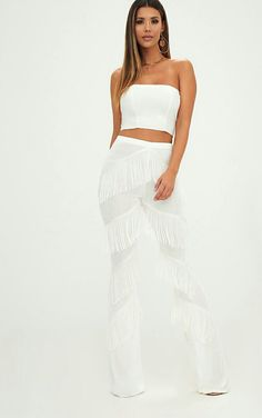 White Slinky Tiered Fringe Flared TrousersIn a slinky white material with white tiered fringing a. All White Outfit, White Outfits, Fringe Pants, Strapless Dress Formal, Formal Dresses, Lace Skirt, Night Out, Trousers, Crop Tops