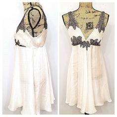"""This is an elegant vintage Oscar de la Renta size Small pink label empire waist ivory tunic sheer sleeveless tank top with black lace applique detail. It would look stunning underneath a fitted blazer and a pair of ripped jeans. It is in great shape apart from a barely noticeable small dot stain on the left side of the bust. It is machine washable and the measurements are as follows~    ~LENGTH- 32 1/2""""  ~ARMPIT TO ARMPIT- 13""""  ~SHOULDER TO SHOULDER- 15 1/2""""  ~BUST- 32""""  ~WAIST- 24""""…"""