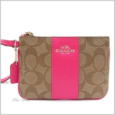 """Coach """"c"""" Signature Pvc/leather Small Khaki/pink Ruby 52860 Wristlet. Get the trendiest Clutch of the season! The Coach """"c"""" Signature Pvc/leather Small Khaki/pink Ruby 52860 Wristlet is a top 10 member favorite on Tradesy. Save on yours before they are sold out!"""