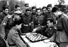 Central Asian Wehrmacht Heer volunteers of the Turkestan Legion play a game of chess on the Western Front. Most members of the Turkestan Legion (German: Turkistanische Legion) were Soviet Army POWs from the modern-day nation of Turkmenistan, with smaller numbers from Kazakhstan, Uzbekistan, Tajikistan, Kyrgyzstan and the Xinjiang Uyghur Autonomous Region of the Republic of China. After surrender or capture, many volunteered to fight for the Germans in the hopes of establishing an independent…