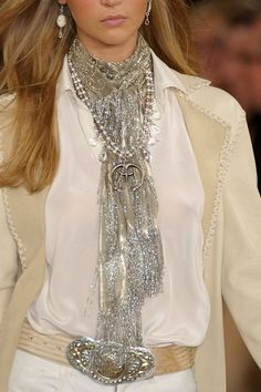 Love her scarf which looks looks like a cross between a scarf and a necklace if you take but one glance!