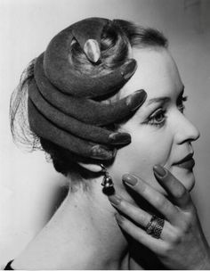I love how unbelievably weird and kind of creepy this is...Hand hat 1953 Photo by Douglas Miller