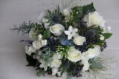 "Very pretty, of this boquet was a little more ""flowly"" it would probably be perfect"