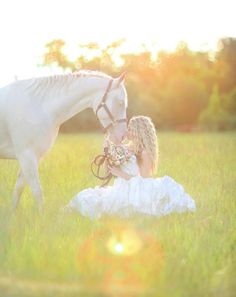 Ethereal and serene beauty - horse, bride and flowers.