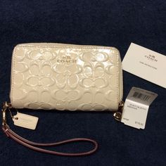 Coach wristlet Coach signature embossed patent leather double zip all away around wallet/ wristlet. Detachable strap to convert to wallet. Strap drop is approx 7 inches. White leather interior with 9 credit card slots and a Id window. Thank you for any likes and share. Will consider any reasonable offer. Coach Bags Clutches & Wristlets