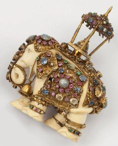 Bejeweled elephant. Carved ivory, gold set with sapphires, rubies, emeralds and precious stones. India. Gros & Delettrez
