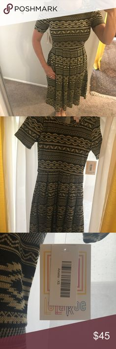 Lularoe jacquard Amelia. Aztec print Brand new. Just purchased and loved it. However, it fits a little snug on the chest. Aztec print. Beige and black. LuLaRoe Dresses Midi