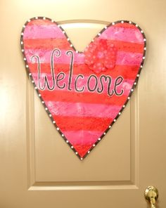 Love is in the air!  Valentine's Day welcome door hanger.
