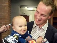 Peyton Manning with one of his twins (credit: CBS)