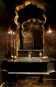 Intaglio effect in a Morrocan bathroom created by an arched mirror ..... TAGS black, gold, exotic, dark, metallic, tile, mosaic, arabic