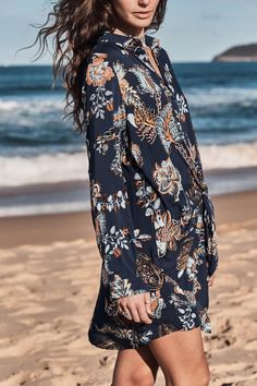 Jet Shirt Dress - The Jaase Jet Wrap Shirt dress is a gorgeous boho dress made from beautiful blue floral fabric. With long puff sleeves and a high neckline this dress is perfect for a sunny winters day walk on the beach.