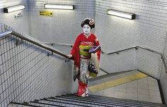 Steve McCurry: The Unguarded Moment - Geisha in subway. Kyoto, Japan 2008