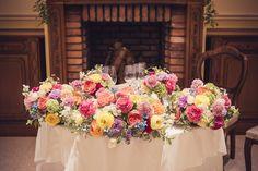 代官山のリストランテASOさんにお届けした会場装花です。 メインテーブルはピンクや黄色のラナンキュラスやライラック、スイートピーなど春のお花をたっぷり使ってカラフルに仕上げました。 wedding,centerpiece,colorful,flower,decor