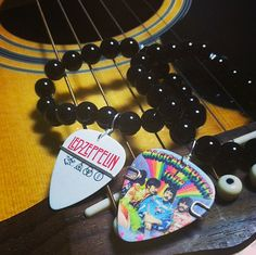 Black Beaded Bracelet with The Beatles Magical Mystery Tour Guitar Pick via Etsy