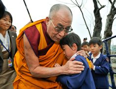 HHDL comforts a young boy who lost his parents to the tsunami last March in Ishinomaki, Japan, on November 5th.       His Holiness traveled to Ishinomaki to meet with the survivors from the area most devastated by the tsunami. Photo/Kimimasa Mayama