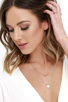 """Bask in the beauty of the moon with the Lunar Phases Gold and Pearl Layered Necklace! This stunning necklace features two layers of gold chain, each accented with a textured, curved bar and a pretty freshwater pearl. Necklace measures 18"""" around with a 3.5"""" extender chain."""