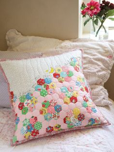 Learn how to create a sweet patchwork-look pillow using cheater-print fabric with the Easy hexie pillow tutorial.