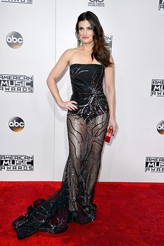 Bedazzled: Idina Menzel wowed in a strapless black dress with sheer skirt Ama Red Carpet, Cavalli Dress, White Shoulders, Idina Menzel, Black Strapless Dress, American Music Awards, White Off Shoulder, Red Carpet Fashion, Celebrity Style