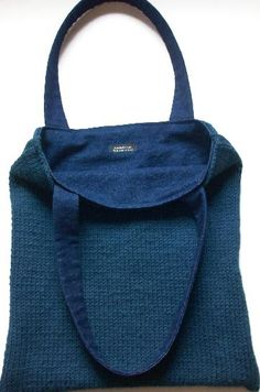 Hand knitted blue, denim tote bag.  Hand knitted and sewn by Tina Kudlick