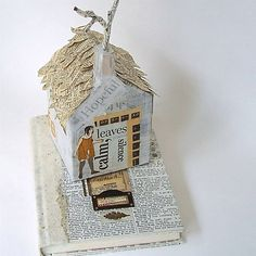 Altered book sculpture by Gathered Together (etsy).