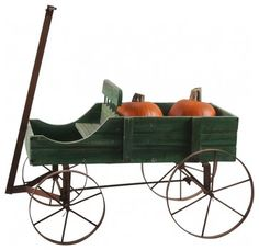 Iron Garden Wagon $150.00	 I picked this up in San Francisco on a picking trip just for you! This wagon features green distressed wood with a gorgeous patina, iron rusty wheels and handle and a wonderful spot for a beautiful plant or other garden elements. 22 length 15 height 10 width