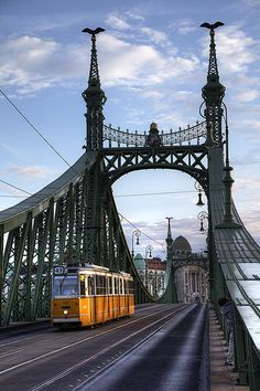 Budapest, Hungary, yellow tram on bridge.