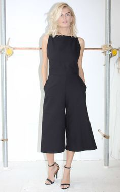 Black culotte jumpsuit in crepe with hidden back-zip fastening and pockets. Shop now.