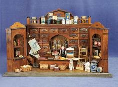 German Wooden Grocery Store with Spice Drawers,  Scales, Doll and Rare Contents