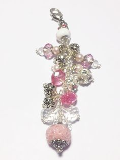 This is a multi beaded chunky purse charm. Each purse charm includes at least 8-20 glass and ornate beads as well as a charm. Purse charm is attached to a large silver swivel lobster clasp. Some purse