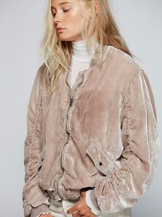Ruched Velvet Bomber | Ultra cool crushed velvet bomber jacket with ruched detailing on the sleeves and ribbed trim. Front zipper closure and hip pockets with snaps. Easy silky lining.