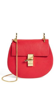 Chloé 'Drew' Leather Crossbody Bag at Nordstrom.com. Chloé's newest take on the saddle bag is the epitome of relaxed modernity: A rounded silhouette mixes with a squared-off flap while gleaming goldtone hardware highlights the bag's soft, grained leather. A single top handle and spacious, suede-lined interior complete the look.